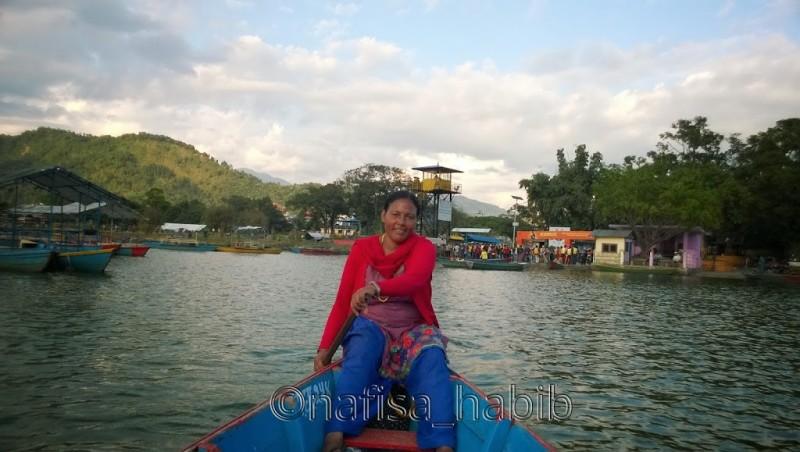 Boatwoman rowing Boat, Fewa Lake