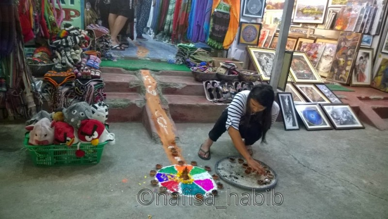 Decorating Rangoli for Tihar in Pokhara