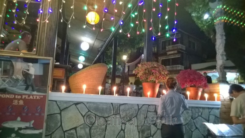 Lighting up candles to celebrate Tihar at Lake View Resort in Pokhara