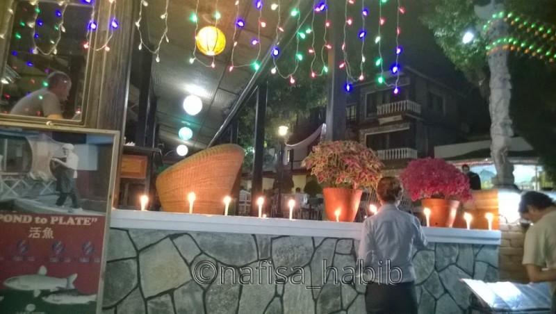 Lighting up candles to celebrate Tihar at Lake View Resort in Pokhara