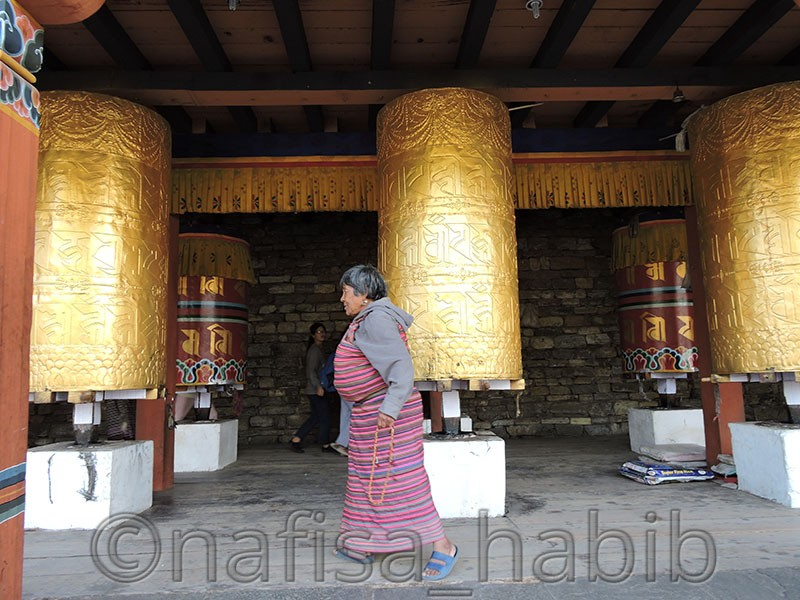 prayer wheels at national memorial chorten - Top Six Places to Visit in Thimphu, Bhutan