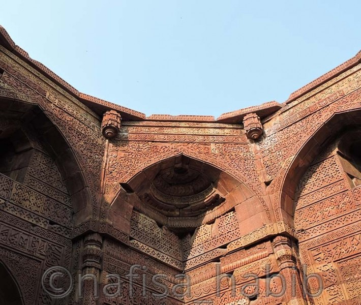 beautiful sculptures with arabic text on qutub minar - Top 3 Must-Visit Beautiful Historical Monuments in Delhi, India