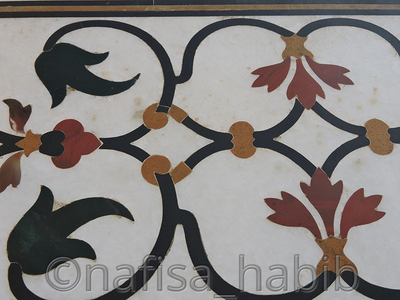 floral marble artwork with the balance of symmetry - Taj Mahal Tour in Agra to Explore the Eternity of Love