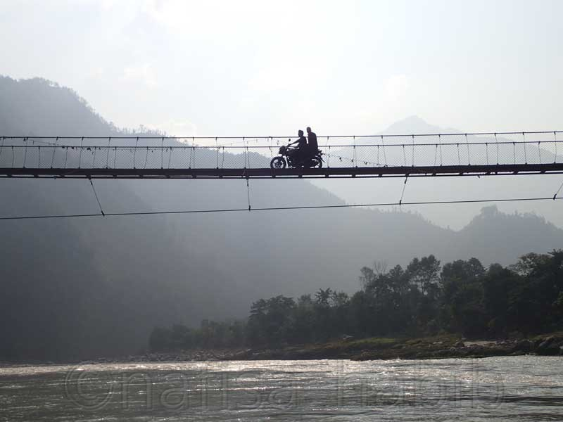 suspension bridge over the trishuli river