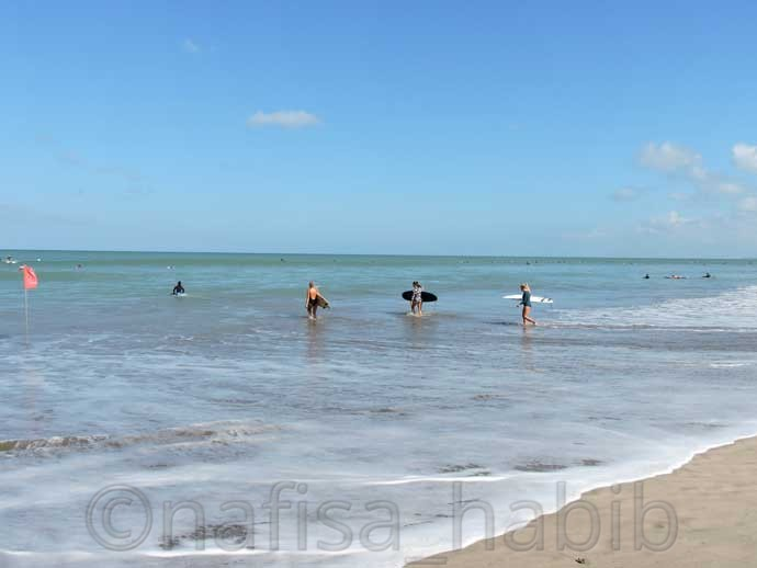 Surfing is the main attraction of Kuta Beach
