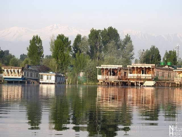 The water reflections of the traditional wooden houseboats