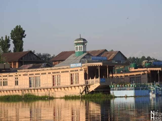 Super Deluxe Houseboat in Srinagar - Young Beauty Star Houseboat Srinagar with a balcony and hanging flower pots