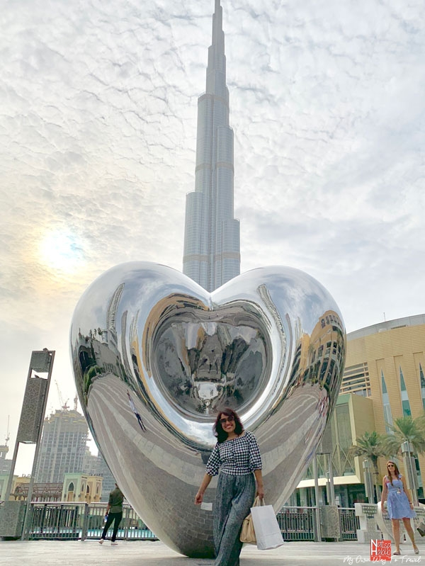 Big heart-shaped Love Me sculpture with the view of Burj Al Khalifa