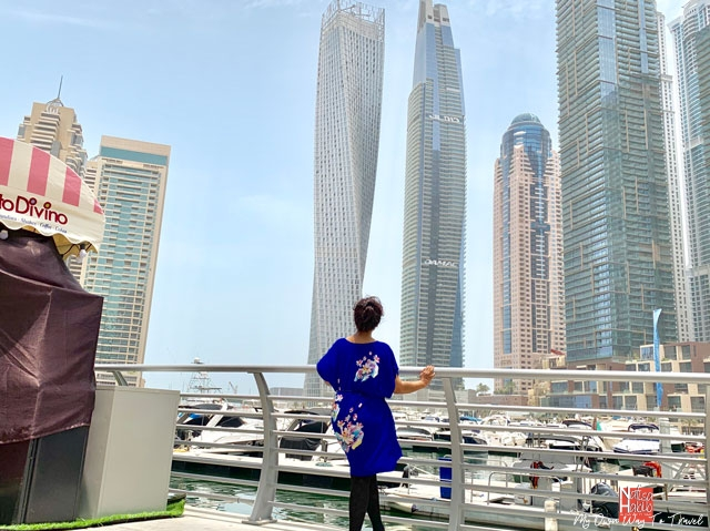 Dubai Marina Walk with the view of the twisted building Cayan Tower