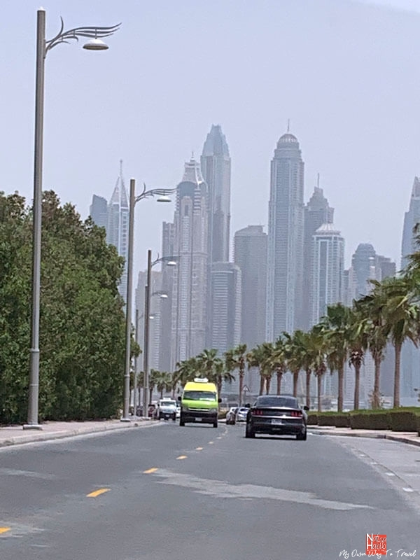 Beautiful road with Palm trees on the Waterfront Promenade of the Palm Jumeirah