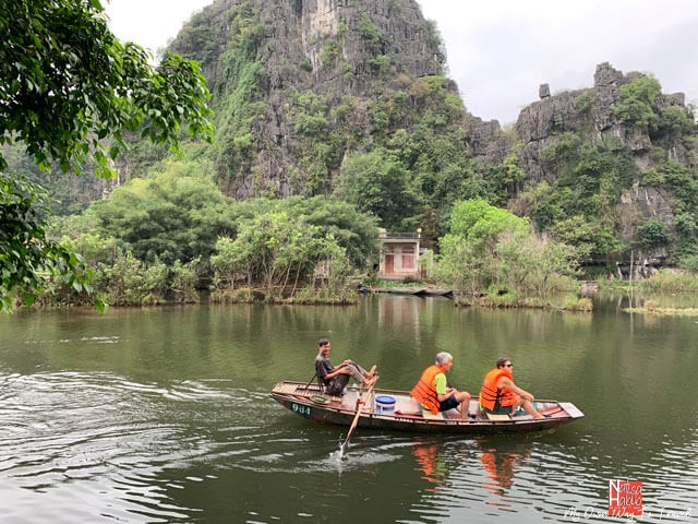 Rowing boat by foot in Ninh Binh
