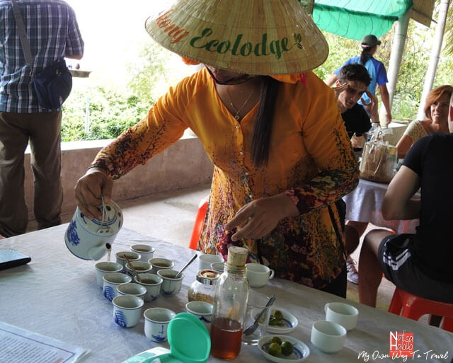 Serving honey tea during Mekong Delta tours
