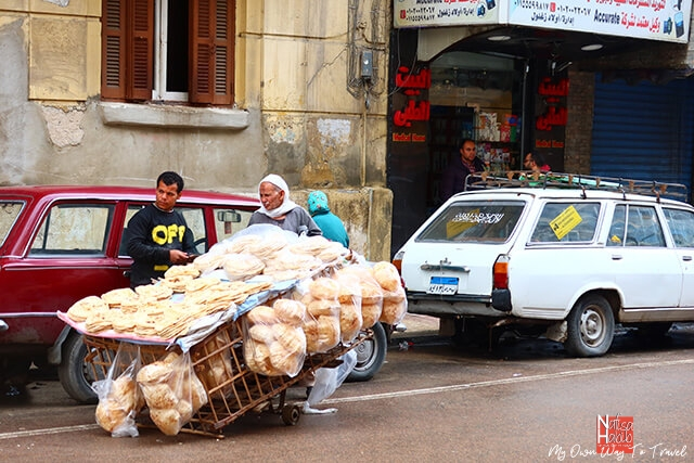 Street vendor selling bread in Alexandria Egypt